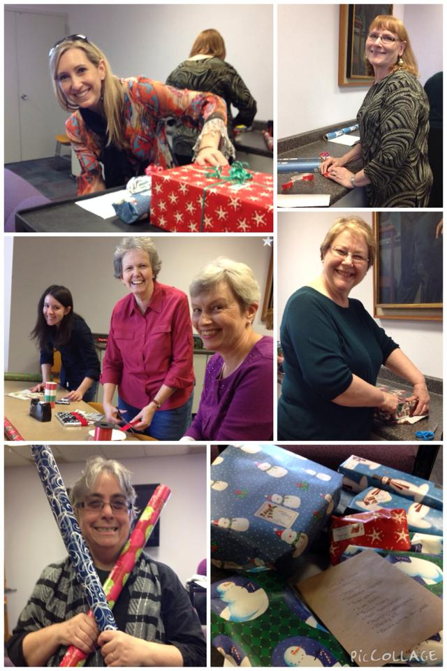 ASU English volunteers wrap gifts for 2014 families.