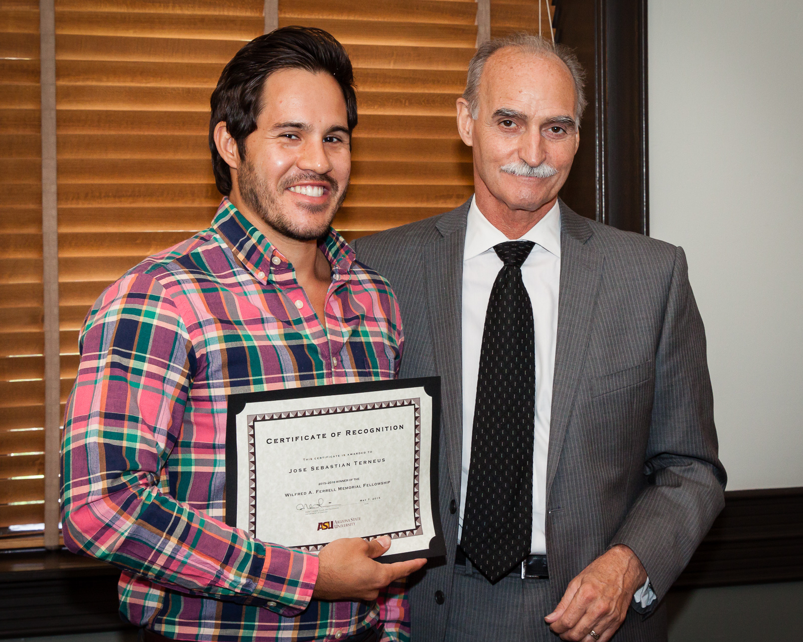 Award-winner Jose Terneus poses with English Chair Mark Lussier / Photo by Bruce Matsunaga
