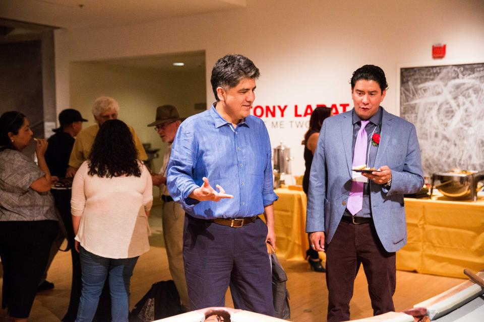 Sherman Alexie was a featured speaker at the RED INK Kickoff event on April 22. He visits with RED INK's Bojan Louis here in this photo by Deanna Dent/ASU Now.