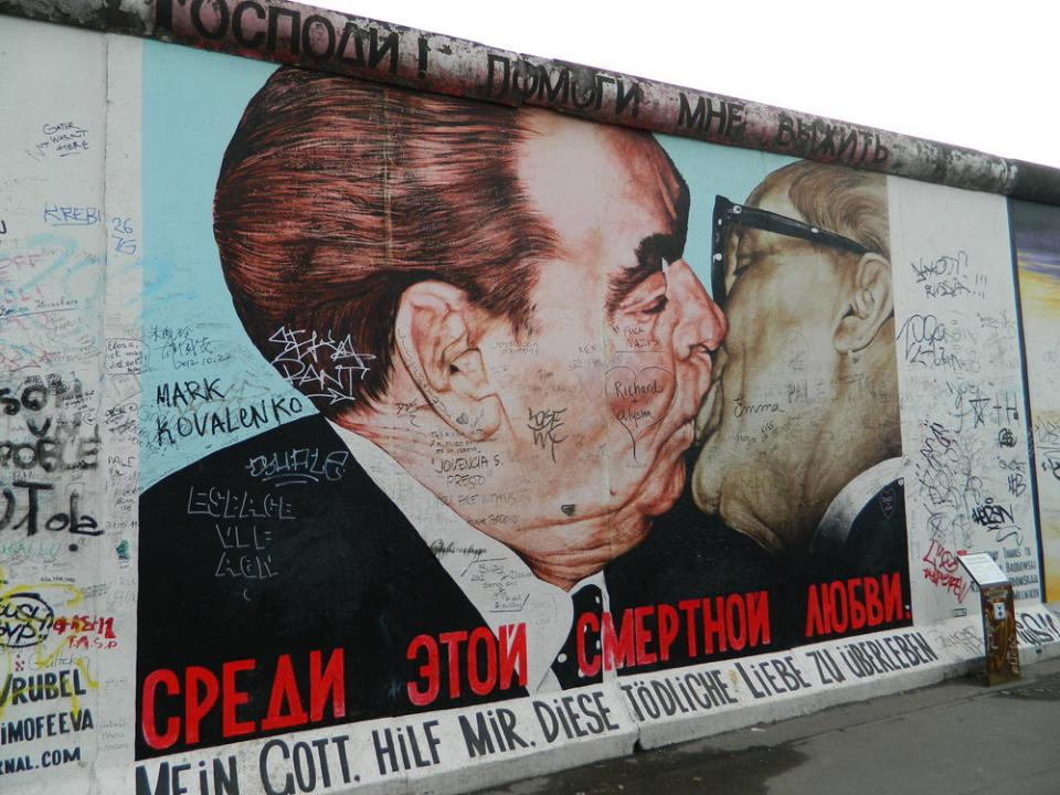 """""""The Deadly Kiss"""" by artist Dmitri Vladimirovich Vrubel on the Berlin Wall / Photo by Freepenguin from Wikimedia"""