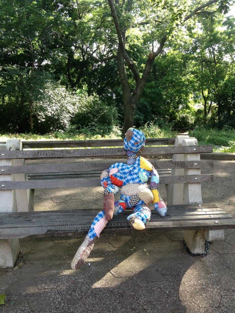 "Susan Bernstein's ""Baby"" quilted doll poses on a bench in Queens"
