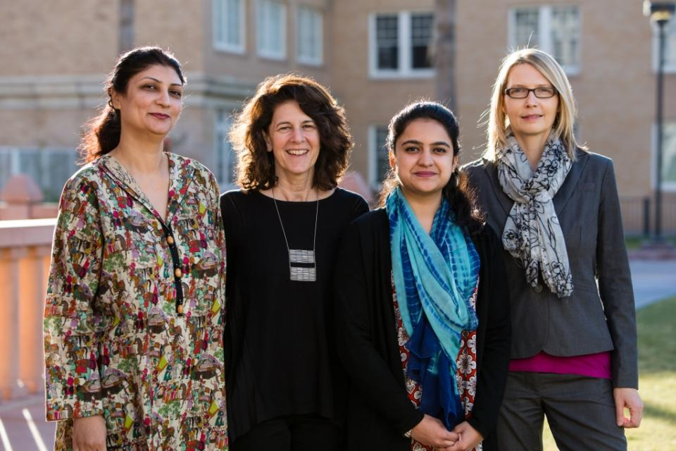 Two of the 2016 cohort of Pakistani scholars (far left and far right) pose with Carolyn Forbes of CSRC and Claudia Sadowski-Smith of English.
