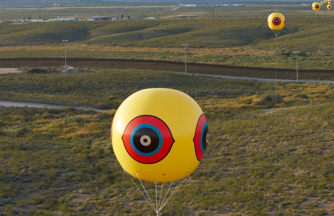 "Close-up of a ""scare-eye"" balloon used in the Repellent Fence installation. / Photo courtesy Postcommodity."