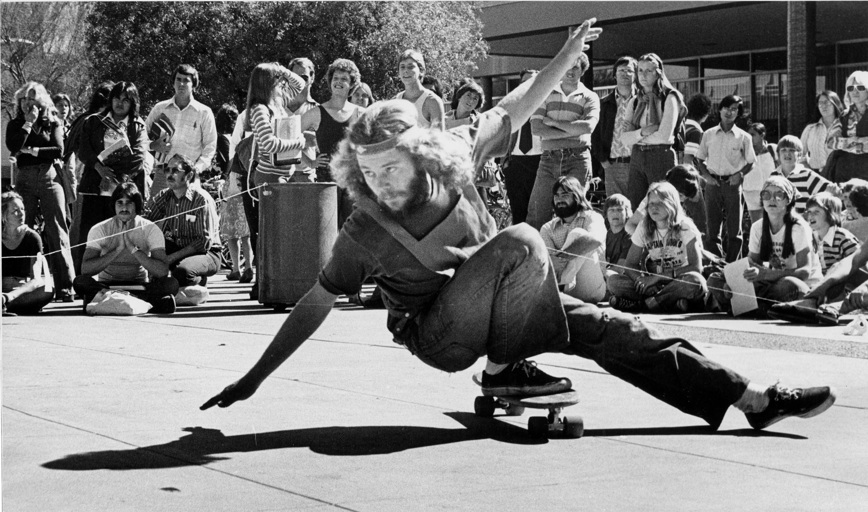 Student skateboarding on the 1970s ASU campus. / Photo from ASU Libraries. UP UPC ASUG S882 1970s #9